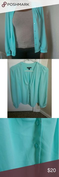 EXPRESS Blue Blouse This is a cute top from Express! You can wear this blouse on any occasion !! This top is in great condition! Feel free to ask me any questions regarding this top!  // NO TRADES. // // Please don't advertise your closet. // Express Tops Blouses