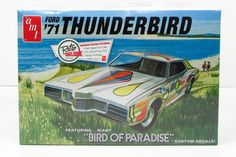 """This 1971 Ford Thunderbird car model kit is made by AMT in 1/25 scale. - Build stock or custom - """"Bird of Paradise"""" decals - 429 cu. in. V-8 engine - High back"""