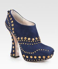 Studded ankle boots by Miu Miu.