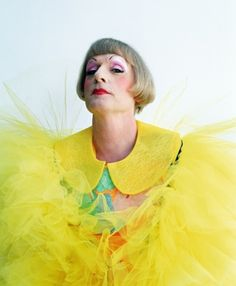 Grayson Perry in a yellow outfit and makeup