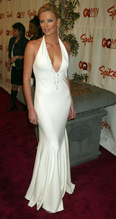 Pin for Later: How Charlize Theron Has Schooled Us All in Sexiness  Charlize looked white hot in a cleavage-baring Ralph Lauren gown at the GQ Men of the Year Awards in October 2003.
