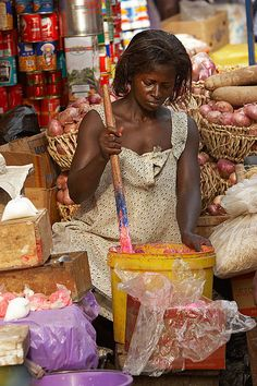 Making food for sale at the market, Kumasi, Ghana. Groceries are available too.