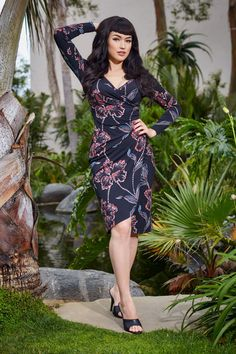 Laura Byrnes California Greta Long Sleeved Wrap Dress in Black Hibiscus Print | Pinup Girl Clothing