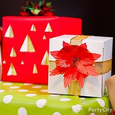 Can you believe this poinsettia was made with a cupcake liner? Click to see how we made the flower and the peek-a-boo wrapping paper!