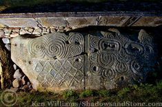 A decorated kerbstone at the great Neolithic passage tomb at Newgrange, Ireland. Shadowsandstone.com Photography by Ken Williams