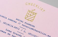Logo as a gold block foil detail across a pink pastel paper designed by Anagrama for event panner Checklist.