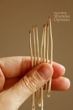 """""""These wooden needles are handmade from the largest thorns of the May-tree also known as 'Crataegus'. This tree/large shrub is know for their long dangerous thorns. ... The thorns are selectively handpicked (so the tree lives on) and made into needles by hand. After making and carving the needle, the wood is protected with a little natural beeswax."""" she also makes knitting needles from pruning wood & crochet hooks from found twigs. very interesting!"""
