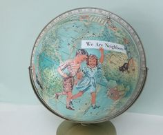 $150. Handmade Altered Art Vintage Rand McNally World Portrait Globe with Decoupaged Images of Children from a 1940s Primer