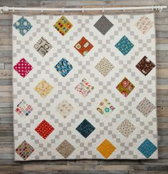 Like the use of bright squares and neutral chain links in this Irish Chain Quilt