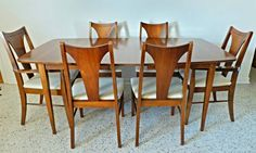 mid century modern 1960's Broyhill Brasilia set of 6 cream leather dining chairs with a walnut dining table and leaf.