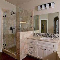 I like this half-wall for the shower. Might work in my bathroom. I'd use a wood-framed mirror & different back-splash behind the sink.   Zillow - Hardwood, Marble - complex, Modern, Rain, Flat Panel, Undermount