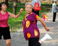 Liu Taitai who is 75 years old plays the Chinese game called 'Jianzi' or 'Hacky Sack' which involves kicking a heavy shuttlecock at the Tiantan Park...
