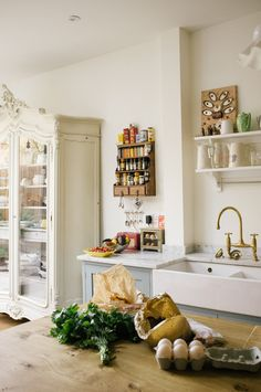 A beautiful shaker kitchen intermingled with vintage pieces