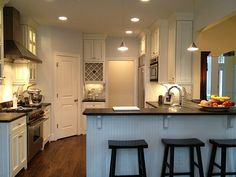 Love that it is open right to the ceiling--no bulkhead.Love the balance of light and darks.
