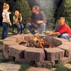Build this simple, attractive stone fire pit ring with retaining wall stone surrounded by flagstone, creating the perfect spot for family gatherings.