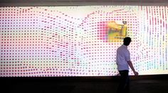 The 36-foot wall at the University of Dayton's admission center engages prospective students and interactively reveals videos of student life at UD. The wall displays continuously changing patterns of generative graphics, which respond to the presence of people in front of the wall.    http://www.flightphase.com/main_wp/expanded-media/interactive-wall-at-ud  Case Study: http://www.flightphase.com/main_wp/case-studies/ud-interactive-wall    Client: University of Dayton