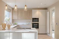 White, wood, and plenty of sunlight - SieMatic kitchen from Dublin, Ireland