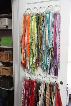 Ribbons! I already have them stored on these book rings on over-the-door hooks...this would give me another layer!