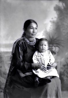 Ho-Chunk woman Martha Lyons-Lowe Stacy (KaRaChoWinKah) holds her son James Stacy (NaHeKah).  tragically James died at the age of two. Photo: 1904.