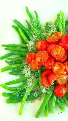 1 pound Cherry Tomatoes, cut in half 1 pound Green Beans. trimmed, 1 pound whole head of Garlic, roasted in Extra Virgin Olive Oil, 4 TBS Olive oil, 1/4 C Parmesan replacement