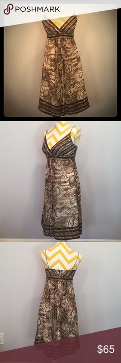 Snake Print Silk Babydoll Never worn, beautiful snake skin print evening dress with metal details on the waistline and a contrast hem. Purchased at Saks Fifth Avenue. The dress is a babydoll style with straps. Beautiful pleaded detail both in the front and back. Fully lined. Shows off cleavage. Dress is 100% silk. Carmen Marc Valvo Dresses Prom