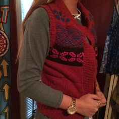 Free People wool fair isle chunky sweater vest REALLY nice and comfortable vest. The outside is a woven red wool and the inside is soft quilted cotton. The buttons are all there and they snap together. only worn a few times ! Perfect condition! Free People Jackets & Coats Vests