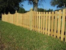 Saddle cut wood picket fence designed by Mossy Oak Fence Company. Perfect for keeping children and pets contained, yet allowing for a view outside of the yard.