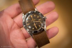"""HODINKEE: On The Block: A First Series Rolex Submariner, But With A Different Name On The Dial---  It looks like a Submariner, doesn't it? In fact, it is.  It dates to 1954, just around the time when the Sub first hit the market.  So, by all accounts, this watch IS a Submariner. But then, if you take a look at the dial, you see it doesn't read """"Submariner"""" like you'd expect to see on a 6204. No, it reads """"Sub-Aqua"""".   So what is a Sub-Aqua?"""