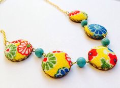 A personal favorite from my Etsy shop https://www.etsy.com/au/listing/386795948/kiiro-chirimen-flower-necklace-japanese