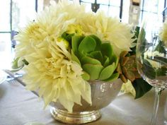 Green succulents and white dinner plate Dahlias in a vintage silver revere bowl.  Pure elegance!