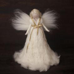 She is a very special Tree Topper Angel, a truly heirloom doll, it would make your christmas tree look so beautiful and magical, She would
