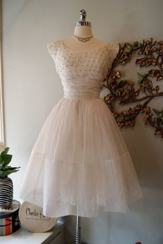 A lovely organdy 1950s wedding dress with a smocked and beaded bodice, ruched waistband, and gathered skirt. ~ via Xtabay Vintage. by luella