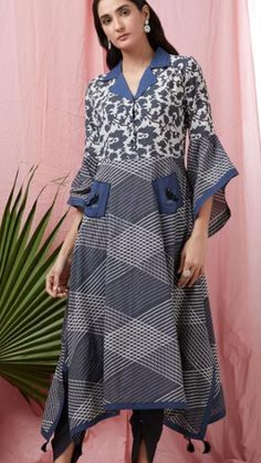 Beautiful Printed cotton Kurti with shawl collar and asymetric bell sleeves.