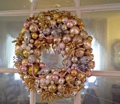 I decided to make a glitzy wreath for our New Year's party. I used gold, silver, and pale pink Christmas ornaments in various size. Pink Christmas Ornaments, Christmas Wreaths, Christmas Decorations, Christmas Ideas, New Years Party, Ornament Wreath, Pale Pink, Floral Arrangements, Vintage Fashion
