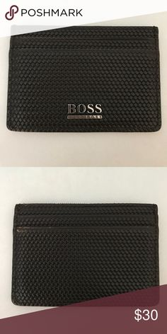Dark Brown Hugo Boss Card Holder Leather material. Color dark brown. 6 slot storage. Silver Hugo Boss logo. * Negotiable on price just let me know * Hugo Boss Accessories Key & Card Holders