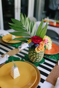 Pineapple flower arrangements are the perfect touch for tropical party decor.