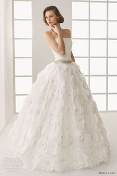"""Two by Rosa Clará 2013 bridal collection. """"The second Rosa Clará line keeps the magic and special character that the house gives to each of its creations at a more affordable price."""" Above, Donatellastrapless tulle and lace ball gown"""