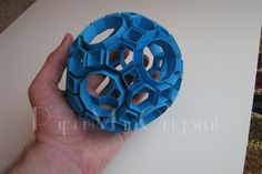 Heinz Strobl Snapology Truncated Icosidodecahedron in hand