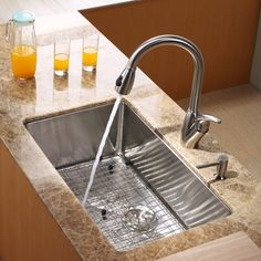 Buy the Kraus Stainless Steel Direct. Shop for the Kraus Stainless Steel Kitchen Combo - Undermount Single Bowl 16 Gauge Stainless Steel Kitchen Sink with Pullout Spray Kitchen Faucet and Soap Dispenser and save. Kitchen Faucet Reviews, Cheap Kitchen Faucets, Bathroom Faucets, Kitchen Sink, Kitchen Appliances, Good And Cheap, Home Buying, Cool Kitchens, Kitchen Design