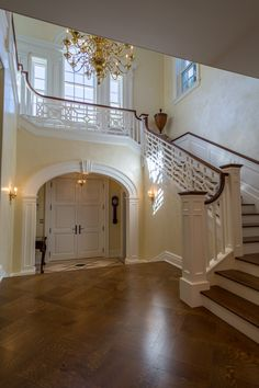 A chinese chippendale rail and the arched entrance door create an elegant entrance.