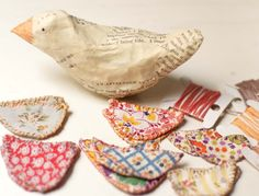 A little birdie told me Paper mache bird with vintage fabric wings on vintage wooden spool.