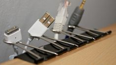 Cord storage hack: clip binder clips onto a desk and store cords in the clips' loops.