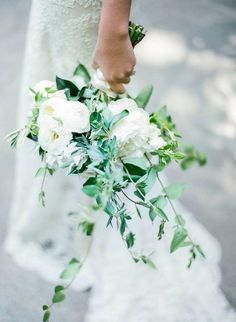 All-white flowers with sprigs of greenery woven throughout - Click for details and more of the top wedding trends to expect in 2016