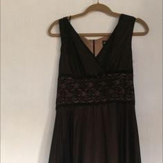 Dress by Connected petite size 10 Dress by connected petite size 10 in excellent condition...no rips or damages of any kind...dress is very pretty and elegant ..perfect for a wedding or New Years party Connected petite Dresses