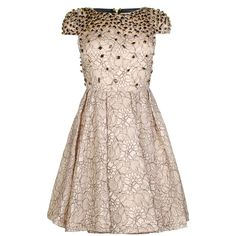ALICE & OLIVIA. Swarovski embellished floral lace dress with a centre back zip closure. This dress features a fitted bodice, a flared skirt, a back mesh panel and capped sleeves.