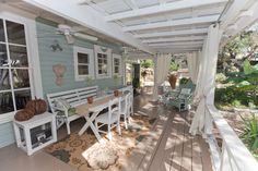 Side porch with outdoor dining area.