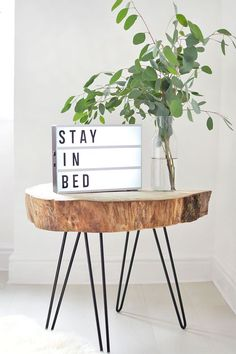 large wood slice table on hairpin legs