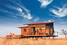 Wolwedans Dunes Lodge | Luxury Hotel in #Namibia, Southern Africa: Dramatic and elegantly appointed #Wolwedans Dunes Lodge is set atop a 750-foot sand dune in a private reserve close to #Sossusvlei. Nine stylish wood/canvas chalets built on low stilts above the sands come with en suite baths and private verandas. The main complex includes two lounges, two dining rooms, a library, a fireplace and a wine cellar, as well as several decks that provide expansive views. #hideawayoftheday
