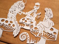 Alice in wonderland hand cut paper art by Paper-Petal via deviantart