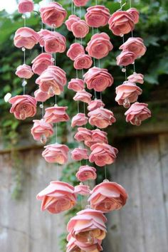 Pink felt flowers with Crystal centres. Could make from paper. Love how they are hanging down. Lovely display for a wedding of garden party.
